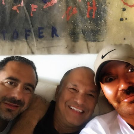 Three gay friends say goodbye and discuss the year long vacation they've shared together.