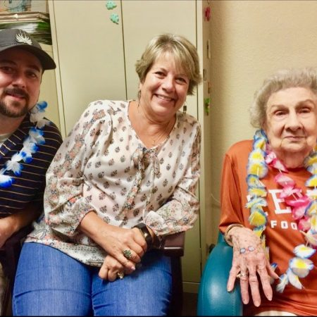 Larry Wortham talks with her grandchild Paul and daughter-in-law Jerry about her life